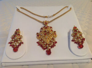Gold finished royal look necklace and earrings set