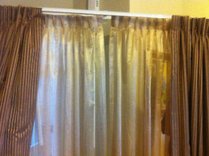 3 Designer Curtains in excellent condition like new.
