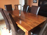 Lovely solid wood dining table with 6 chairs and matching sideboard