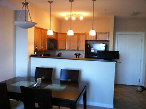 BEAUTIFUL WEST AIRDRIE CONDO WITH STORAGE AND UTILITIES