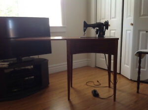 Singer sewing machine with hard wood cabinet