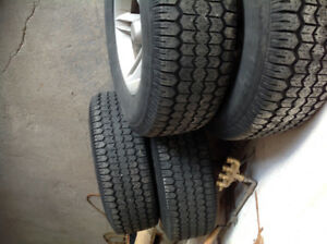 Used tires with rims and nuts