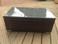 Brown rattan coffee table with crome feet NEW