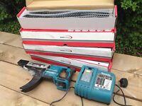 Makita screw gun with 4 boxes of screws