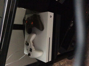 Selling new Xbox oneS with 2 controllers w- games. 2 months old