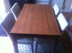 Light walnut modern table with four leather chairs