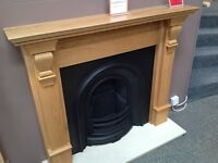 Oak Wooden Mantel with Black Cast Insert Interior including Coral Cream Marble Hearth