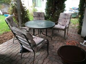 Table,4chairs,and swing. In good condition. $110.