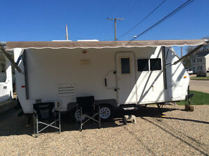 2008 Custom  built 23 ft bumper travel trailer with slide out.