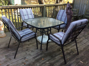Patio table, umbrella and 4 chairs with cushions