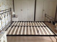 Kingsize metal frame bed with crystals