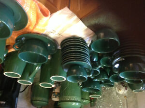 Green stoneware cups and saucers