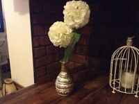 New allium flower and silver vase