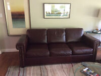Burgundy leather chesterfield and chair