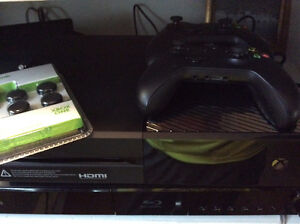 Xbox One with 2 controllers and 7 games