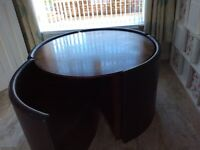 Round dining table with 4 hide away chairs