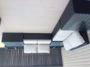 Black rattan patio sectional or sofa with glass table tops
