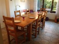 Very large solid oak dining table with solid oak chairs