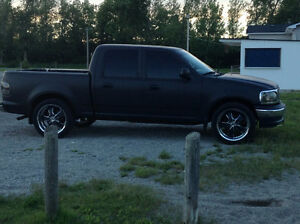 2001 Ford F-150 matte black vinyl  wrap Pickup Truck