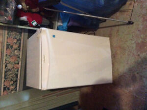 For sale a little bar fridge white in Color works great