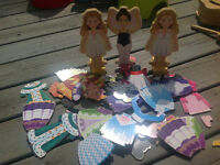 Three sets of magnetic dress up dolls
