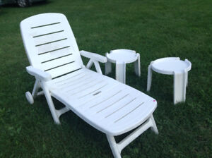 White lounger with side tables