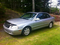 2005 Kia Magentis LX Sedan-needs motor,price reduced $1000