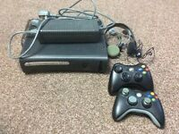 120gb Xbox 360 with two controllers and two headsets complete with power lead.
