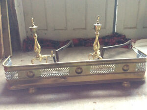 Antique, brass fireplace fender and brass andirons