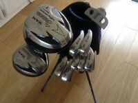 GOLF CLUBS FULL SET OF LIGHT WEIGHT CAVITY BACK IRONS WITH STEEL SHAFTS. WOODS PUTTER AND BAG etc .
