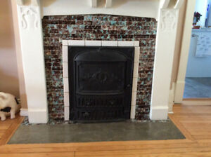 ANTIQUE CAST IRON FIREPLACE INSERT CIRCA 1908
