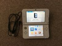 Nintendo 3DS XL console with game