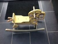 Traditional wooden child's rocking horse