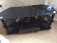 Black glass corner TV stand and shelving unit