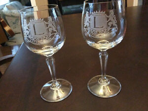 2 Wine glasses with satin frost Lions emblem imprint.