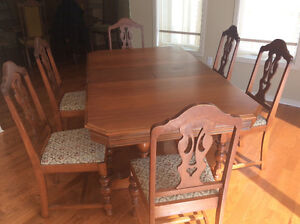 Solid walnut pedestal table and six chairs $195.00