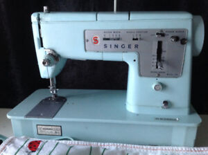 Beautiful turquoise Singer sewing machine with case.
