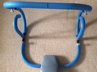 Abs Trainer Trimmer/Roller with headrest.