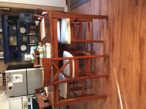 Island style dinning table and 6 high back stools