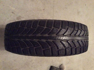 4 winter tires 185x65r14 mounted on rims.