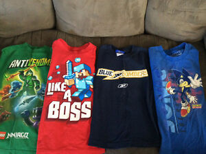 11 boy's shirts. Size 7/8.