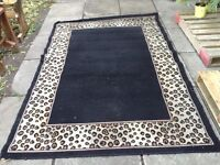 """really nice black/brown carpet 63"""" x 90"""" (need cleaning)"""