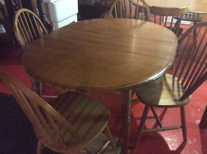 Round, extendable solid maple kitchen table and four chairs.