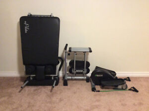 AeroPilates ,and two other pieces of exercise equipment