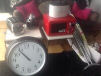 Kitchen items, microwave,kettle,toaster,wall clock and more.