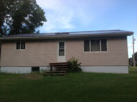House and garage for sale to be moved