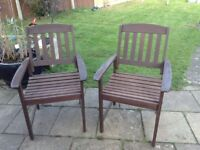 Pair of solid wooden garden chairs