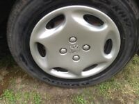 PEUGEOT 13 inch WHEEL TRIMS/HUB CAPS. SET OF FOUR FOR PEUGEOT 206 or 306.