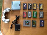 Blue gameboy with games and other