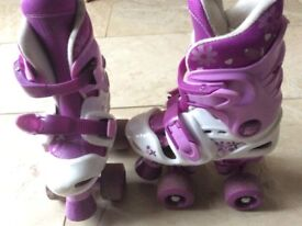 Pink and purple roller skates. Size 10-11